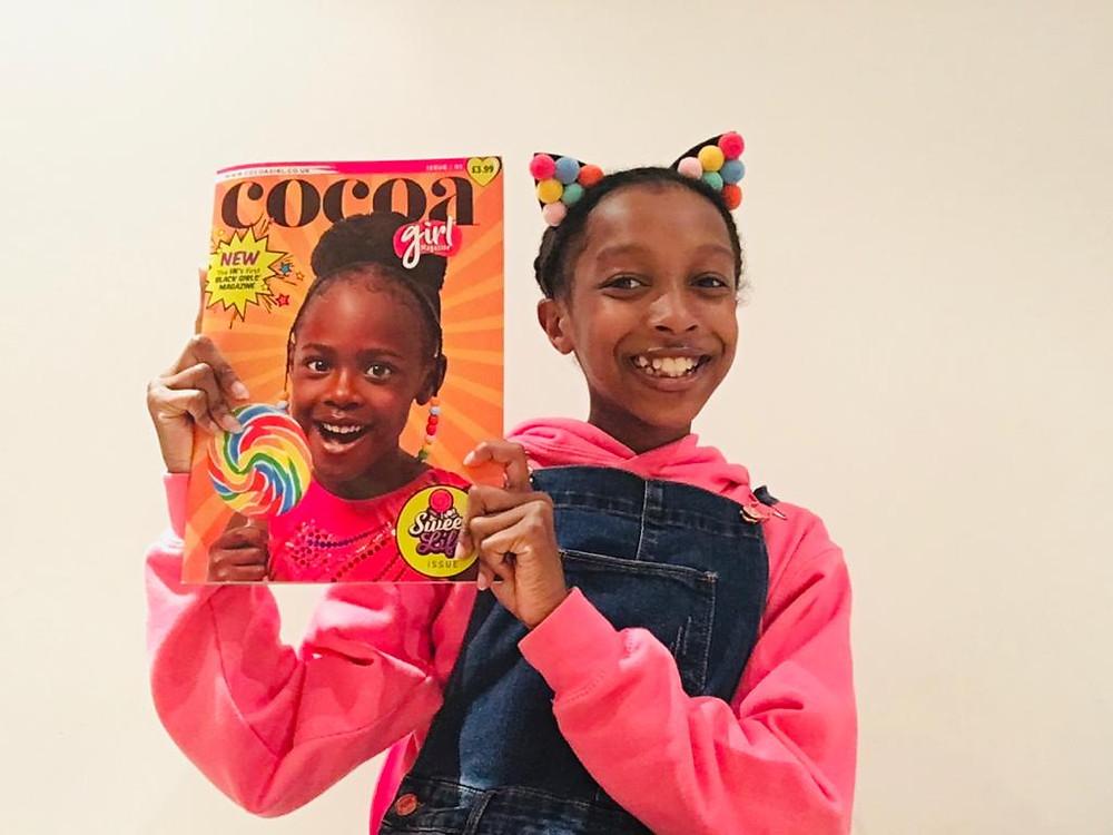 Maya Glitters holding Cocoa Girl Magzine