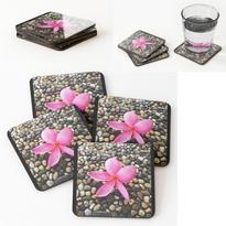 Pink Frangipani on a Pebble Path Coasters.png