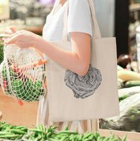 tote-bag-mockup-featuring-a-woman-shoppi