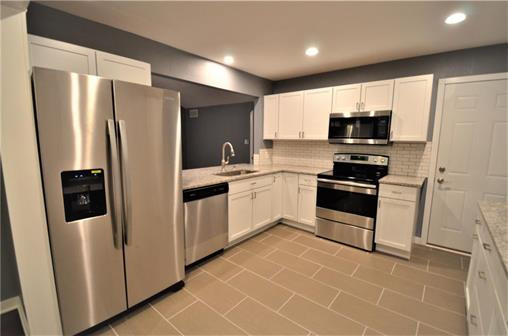 new kitchen with granite counter tops, custom subway back-splash and stainless steal appliances