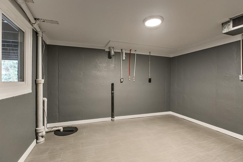 Large laundry room: 6345 Robin Hood Dr, Merriam, KS 66203 home for sale