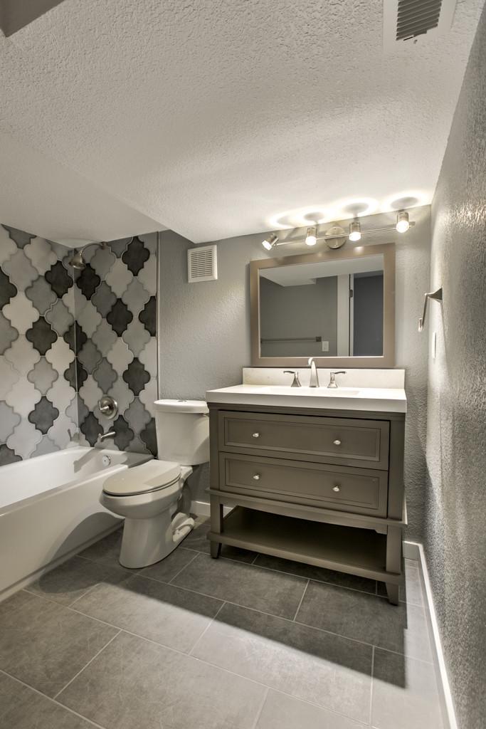 Brand new guest bath in basement, custom tile work: 6345 Robin Hood Dr, Merriam, KS 66203 home for sale