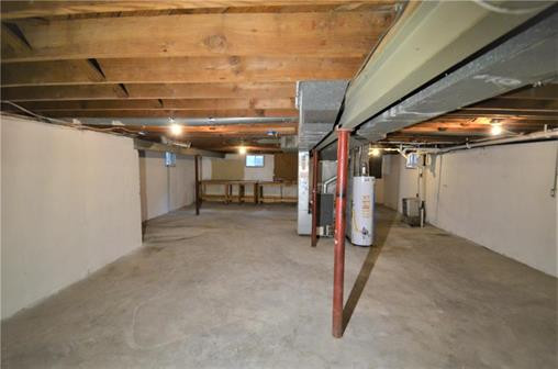 6108 Northern Ave., Raytown, MO 64133 - Home For Sale - full size, clean unfinished basement