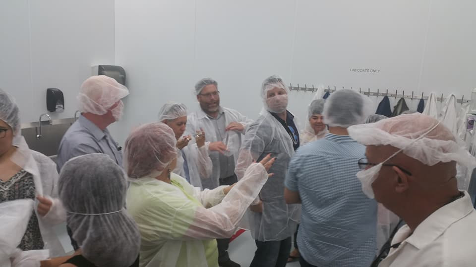 getting dressed in our clean suits at the Ariix FDA OTC facility in Slat Lake City UT.jpg