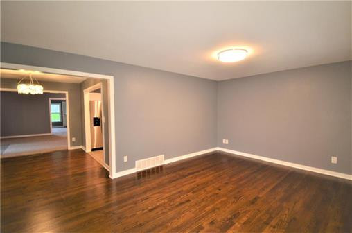6108 Northern Ave., Raytown, MO 64133 - Home For Sale - living room with restored hardwood floors