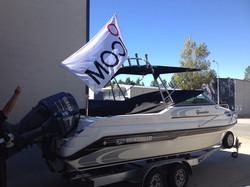 Scott's boat flying the flag