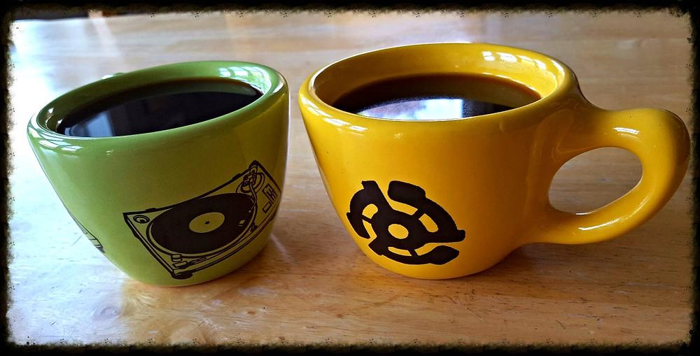 two ceramic coffee mugs - green and yellow