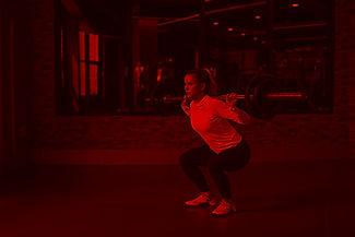 woman-lifting-barbell-371049_edited.jpg