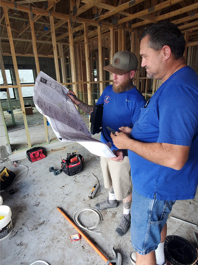Peay's Crewmembers reviewing building plans