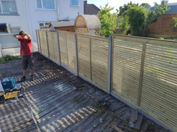 Heritage Single Slatted Contemporary Panels with Concrete Posts & Concrete Gravel Boards