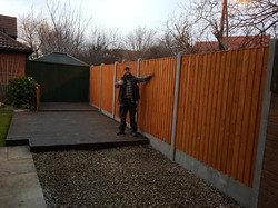 Vertical Feather Edge Close Board Panels with Concrete Posts & Concrete Gravel Boards.