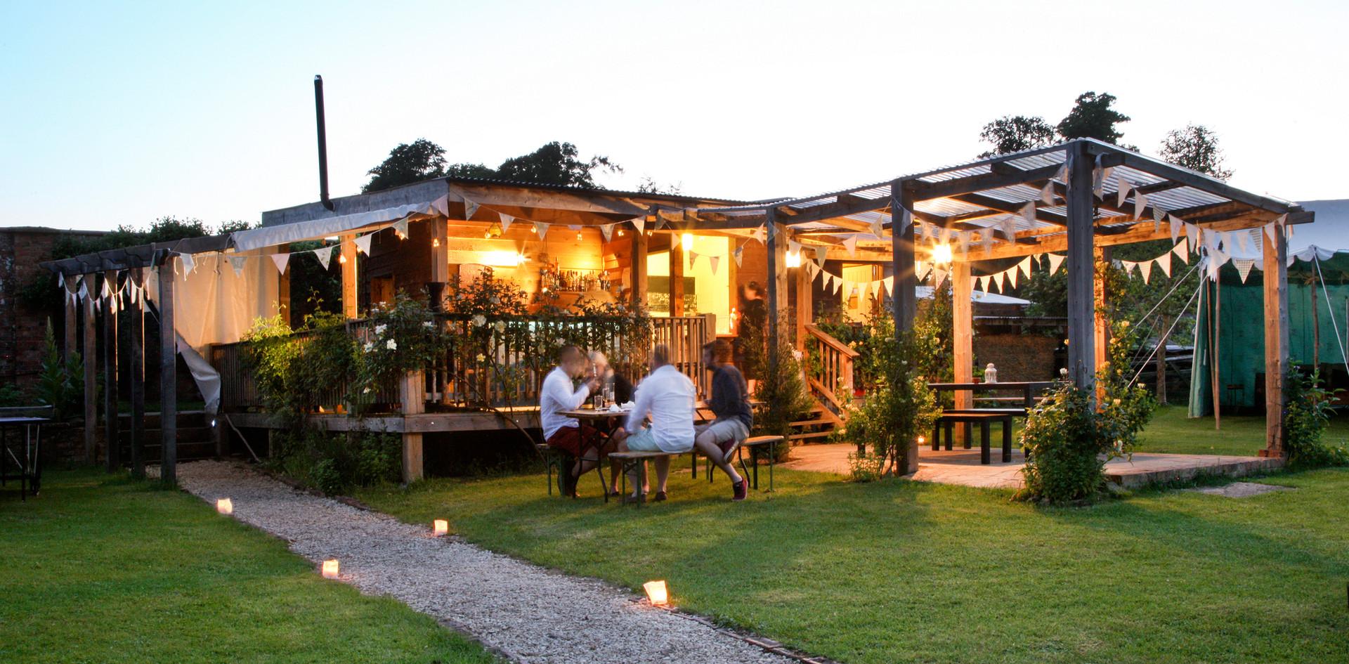 The pavilion pergola bar at dusk