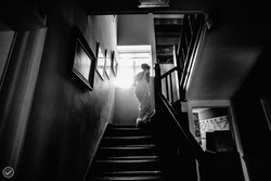Bride disappearing upstairs