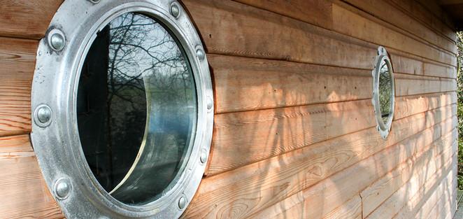 Portholes on Tree Boat-house deck