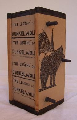 The Legend of Dunkelwolf.jpg  Scroll Book.jpg 10 in.jpg x 5in.jpg x 5in.jpg Wooden box, dowels, chin