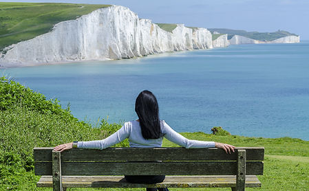 Thoughtful image of woman gazing over bay