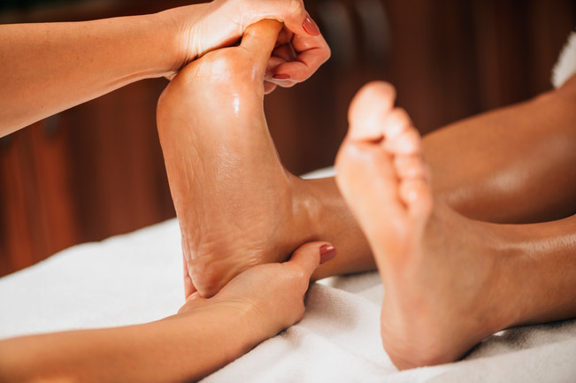 woman-receiving-foot-massage-from-female