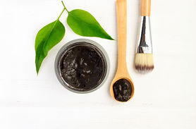 Black clay mineral facial mask in jar wi