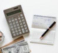 Calculator, money, check book