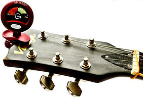 Tuner on a guitar headstock.jpg