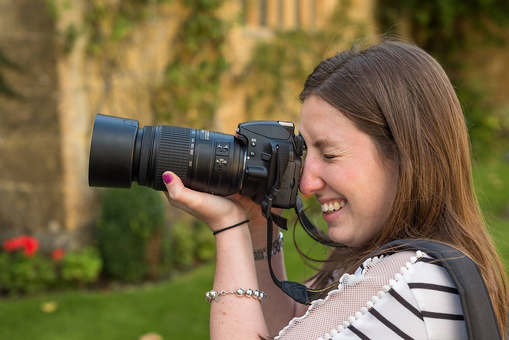 Girl with DSLR and lens