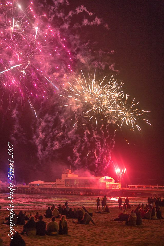 Fireworks with beach and pier