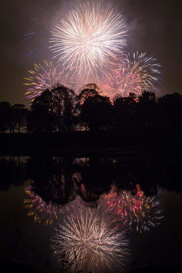 Fireworks reflected in a lake
