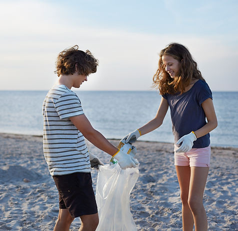 Teenagers cleaning up the beach in Malta.