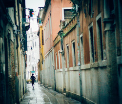 Boy running in Venice