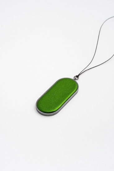 large oval pendant with metallic leather