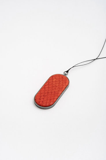 large oval pendant with embossed leather