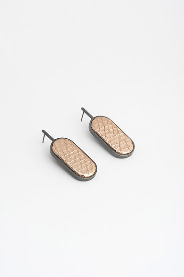 large oval earrings with embossed leather