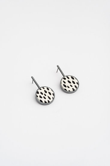 small circle earrings with black and white leather