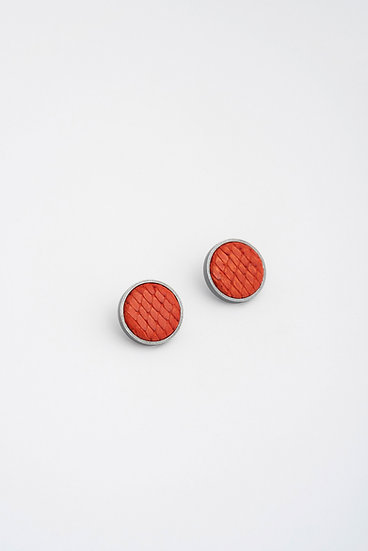 small circle stud earrings with embossed leather