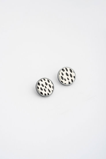 small circle stud earrings with black and white leather