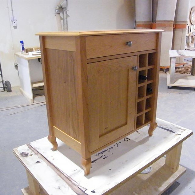 Check out this cool little bar cabinet w