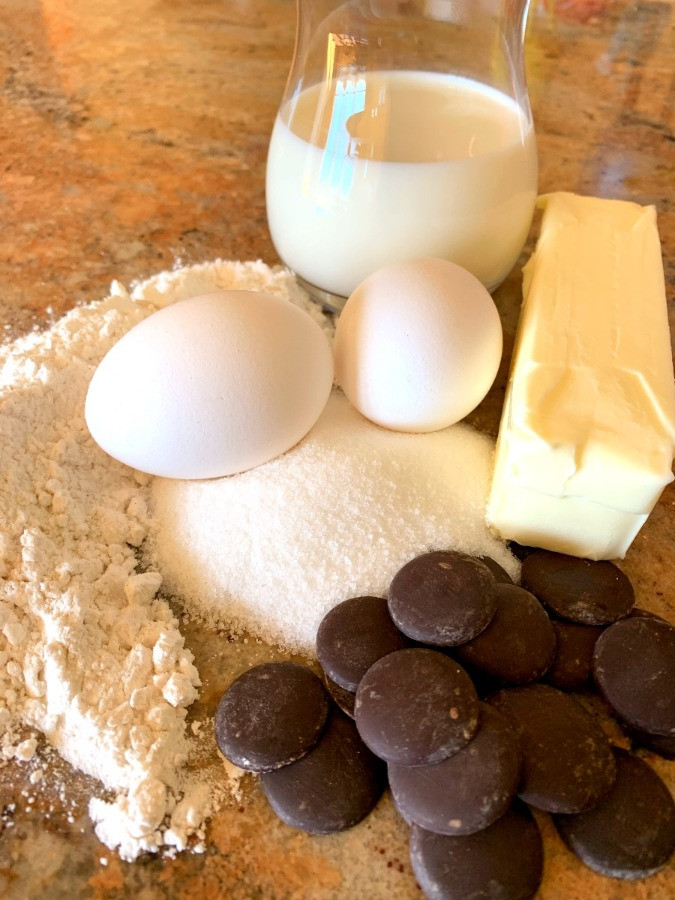 Fresh ingredients - eggs, milk, flour, sugar, dark chocolate, butter