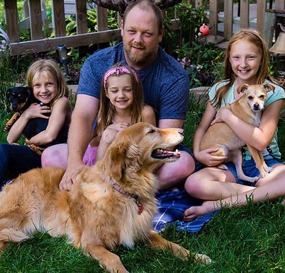 Still a happy family, because kids and dogs all learned the magic word in dog training class.