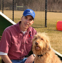 Eric Baechtold, Lead In-home Trainer, Basic Manners and Puppy Specialist, with a member of his team