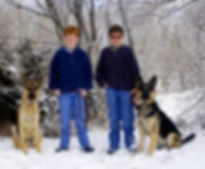 German Shepherds Ellie and Lewis, with their boys, after dog training