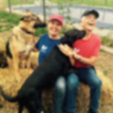 Ken and Lisa Baechtold having fun with their well-trained rescue dogs