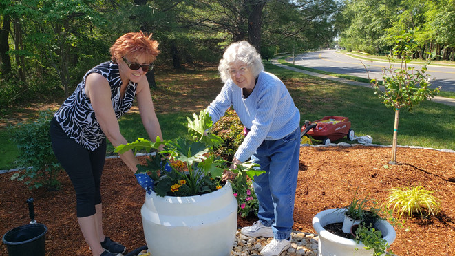 Ingrid and Carol adding some finishing touches to the RV Garden at the corner of Yorkwood and Lions Head Blvd South. (May 2021)