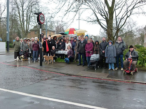 Supporting residents gathered on the corner of Elgin Road