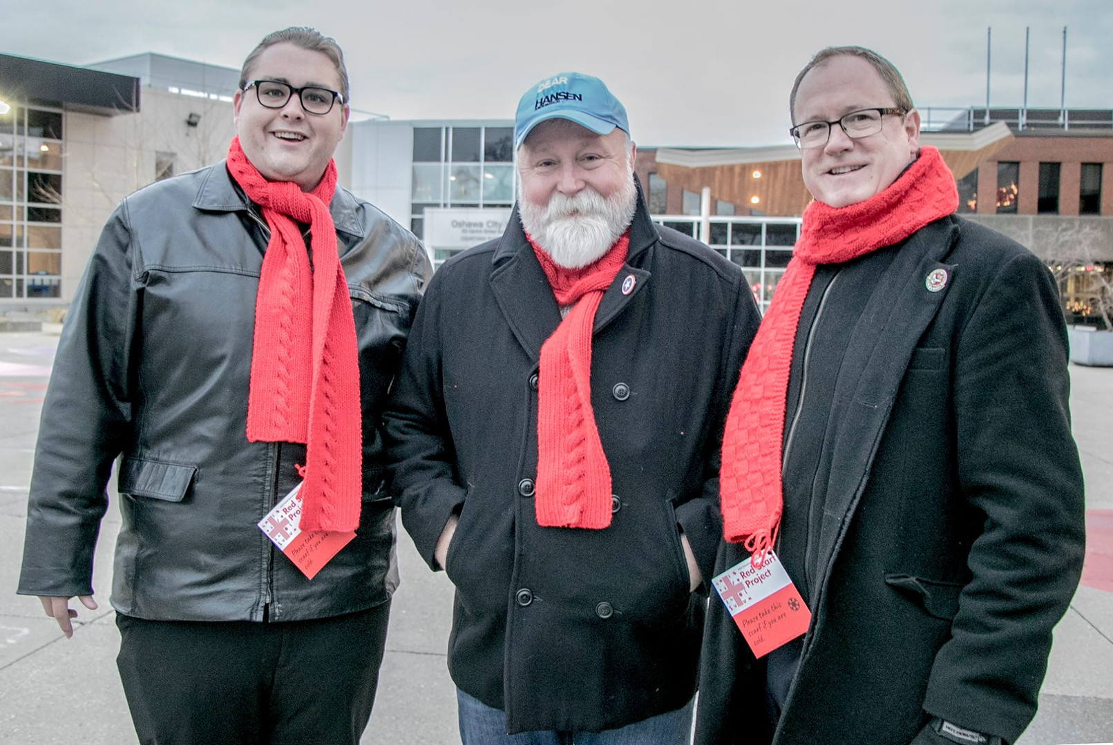 Eric with ACDR Executive Director Adrian Betts and MP Colin Carrie on World AIDS Day