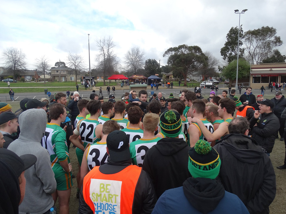 Reserves coach Matt Ford addresses the troops