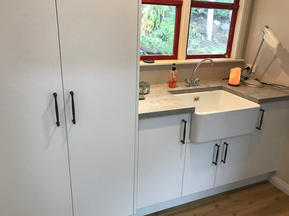 Laundry renovation. Cabinetry. Butler sink.