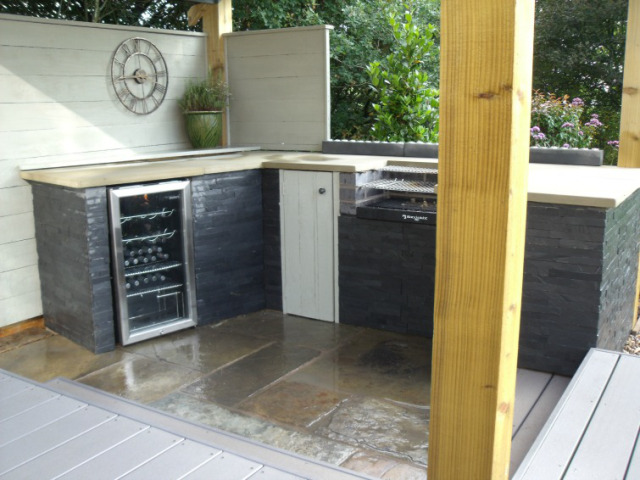 slate tiled, wooden worktops in outdoor kitchen