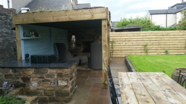 Covered fireplace and kitchen in North West