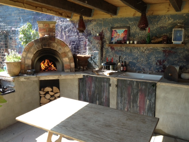 Wood fired pizza oven in outdoor kitchen