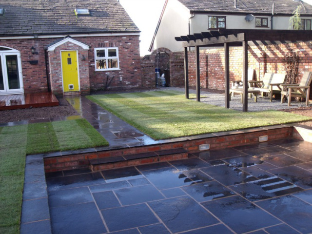Pergola and sunken cooking and relaxing area in Astley